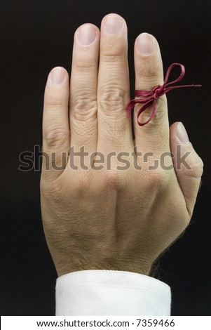 open hand with red ribbon, don't forget - stock photo