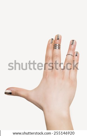 Open hand with rings.