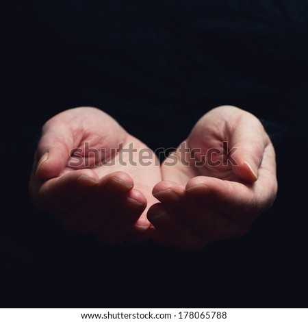 Open hands. Holding, giving, showing concept. Selective focus on fingers. - stock photo