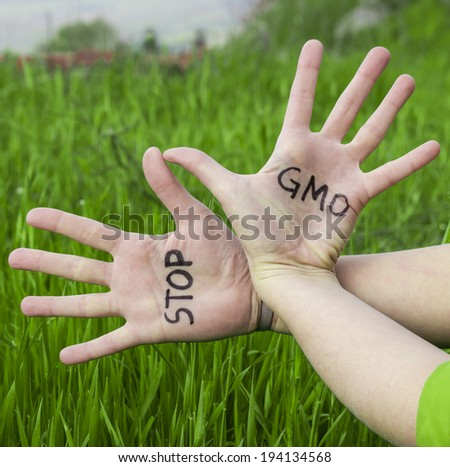 Open hands raised, Stop GMO - stock photo