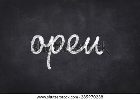 open handwritten text on chalkboard
