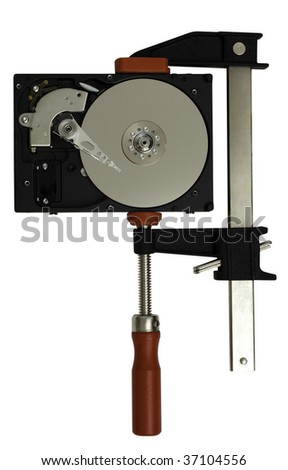 Open hard disk drive in a clamp or vise to visualize the concept of data storage and compression, isolated on white background