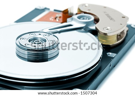 Open hard disk drive, shallow depth of field with focus on the disk