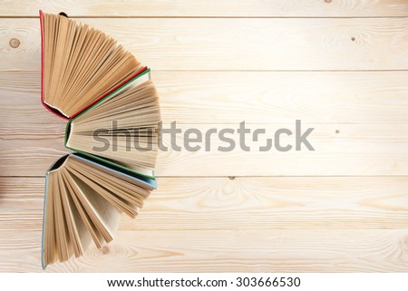 Open hardcover books on wooden table. Back to school. Copy space. Top view - stock photo