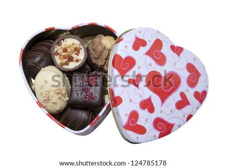 open heart box filled with delicious pralines on a white background - stock photo