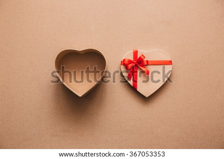 Open heart box with space for text on kraft paper.