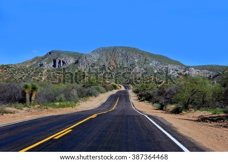 Open highway in Arizona with winding road - stock photo