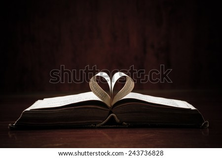 Open holy bible on a table. Ideal for a text messages. - stock photo