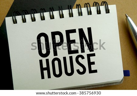 Open house memo written on a notebook with pen - stock photo