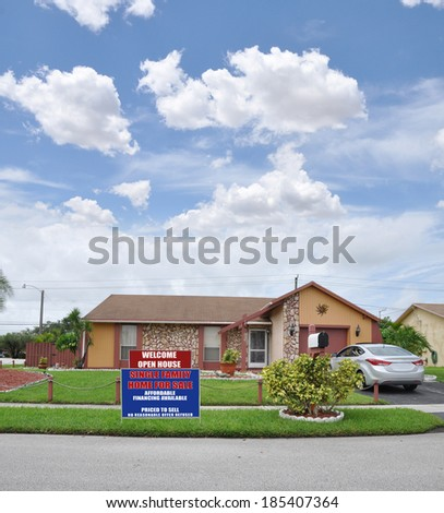 Open House Welcome Real Estate For Sale Sign Suburban Ranch Style Brownstone Home Landscaped residential neighborhood usa blue sky clouds