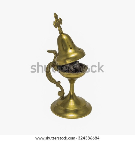 Open incense burner with a cross isolated on a white background