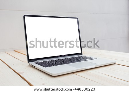Open laptop with blank screen on wooden desk
