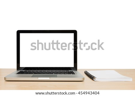 Open laptop with isolated white screen and book on wooden desk