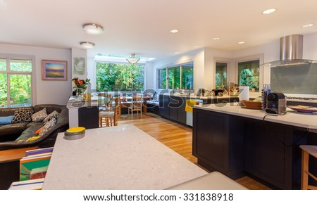 Open layout kitchen, with family room adjacent, back in use following an extensive remodel - stock photo
