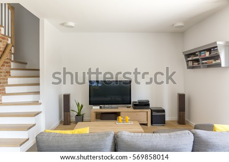 Open Living Room With Tv, Sofa And Staircase