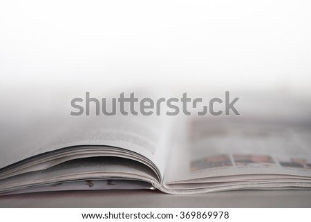 Open magazine on a table with shallow depth of field