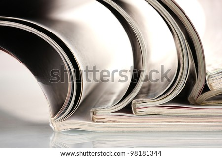 open magazines isolated on white - stock photo