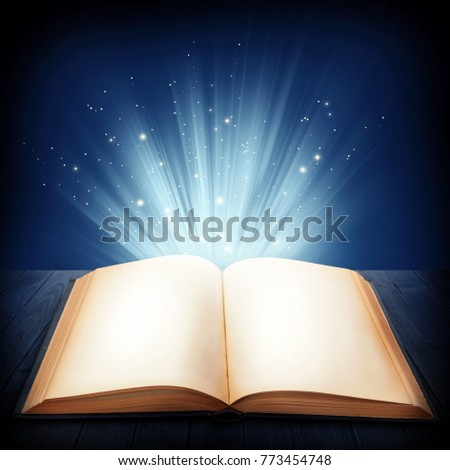Open magic book on a blue background