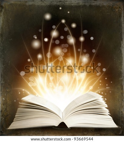 Open magic book on a dark background and lights - stock photo