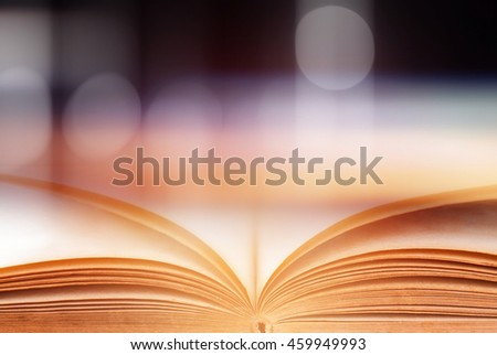 Open magic book on wooden background