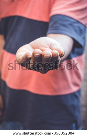open male's hand begging for money
