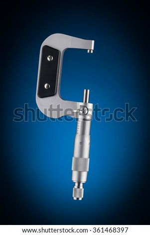 Open micrometer side view isolated on blue background