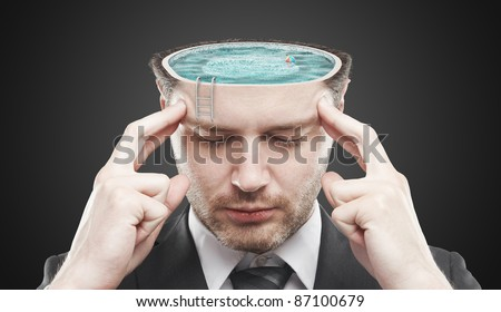 Open minded man with swimming pool inside thinking about relax.Conceptual image of a open minded man. On a black background - stock photo