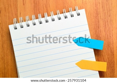 open note book. Colorful Sticky paper arrows - stock photo