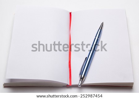 open note book with empty pages with pen on the table - stock photo