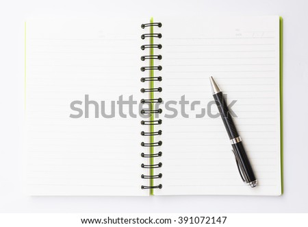 Open notebook and pen on the white background