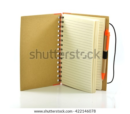Open  notebook coil binding with orange pen - stock photo