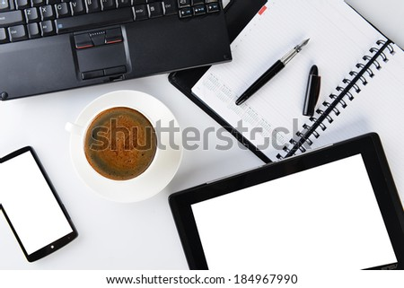 open notebook, mobile  phone,  pen and cup of coffee
