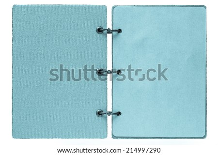 open notebook on a white background with a cover from fabric and with paper pages of blue color