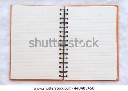 open notebook on fabric background, Top view