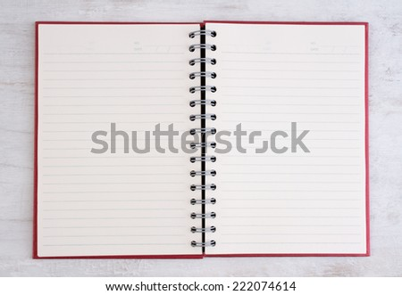 Open notebook on grunge background  - stock photo
