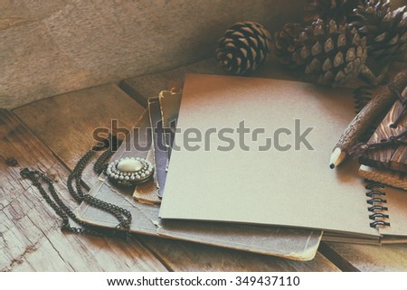 open notebook on wooden table. retro filtered image  - stock photo
