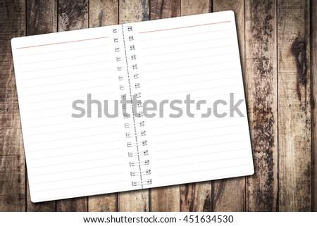 Open notebook paper page with red line on wood background for design with copy space for text or image. - stock photo