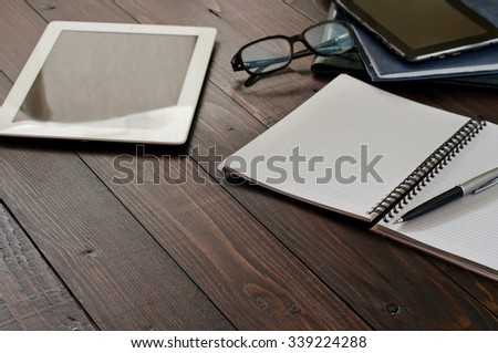 Open notebook, tablet computer, glasses and leather business folders on the office table. Top view with copy space. Free space for text. Office workplace - stock photo