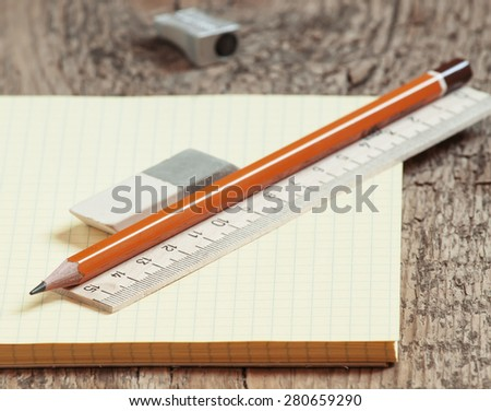 Open notebook with a pencil, selective focus - stock photo