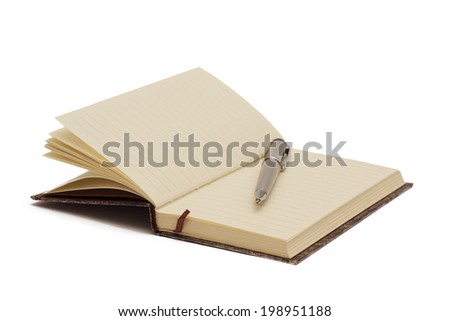 open notebook with gray metal ballpoint pen