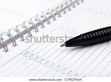 Open notebook with pen on clean sheets