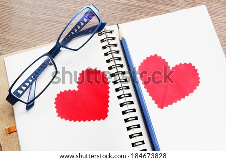 Open notebook with pencil and glasses,  business concept - stock photo