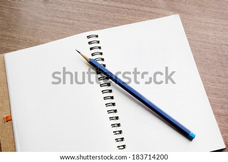 Open notebook with pencil and glasses, bussines concept - stock photo