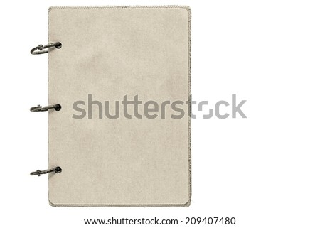 open notebook with sheets of pages from paper of beige color and binder rusty metal rings on a white background - stock photo