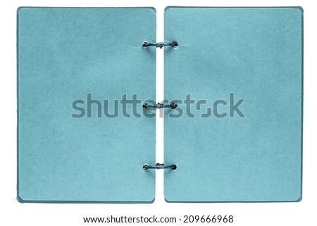 open notebook with sheets of pages from paper of blue color indigo and binder rusty metal rings on a white background