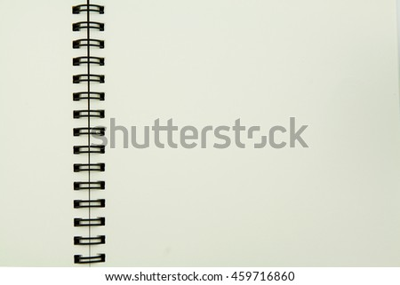 Open notebook with space on white background.