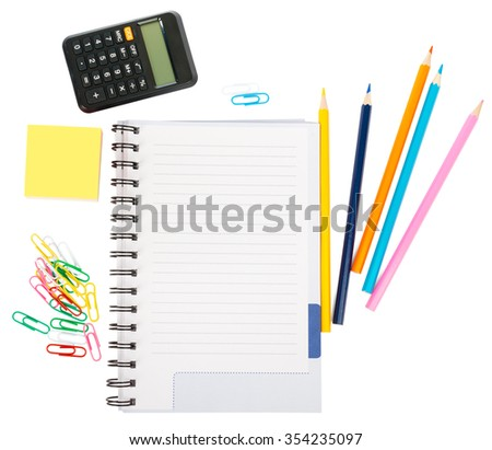 Open notebook with stationery and calculator isolated white background, closeup