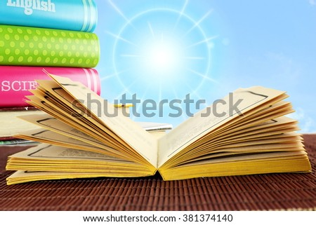 Open old book isolated on sky background