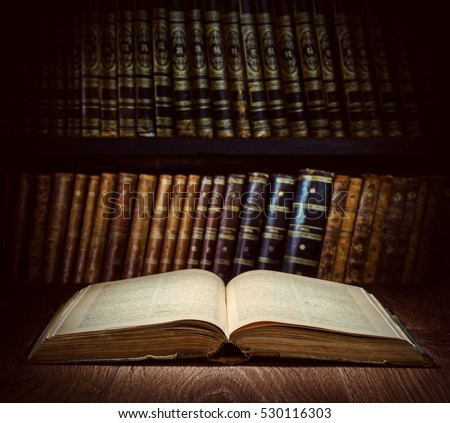 Open Old Book On A Bookshelf Background Selective Focus