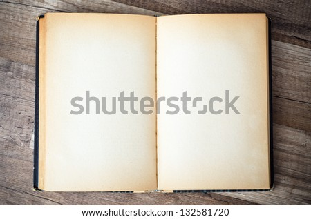 open old book on a wooden surface - stock photo